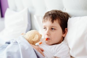 Fieberthermometer im Mund